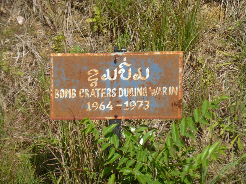 sign in one of the bomb craters that surround the pain of jars