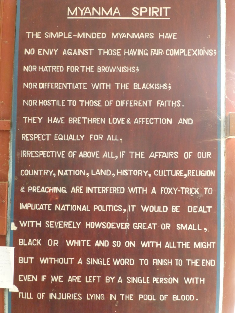 a sign in the myanmar immigration office