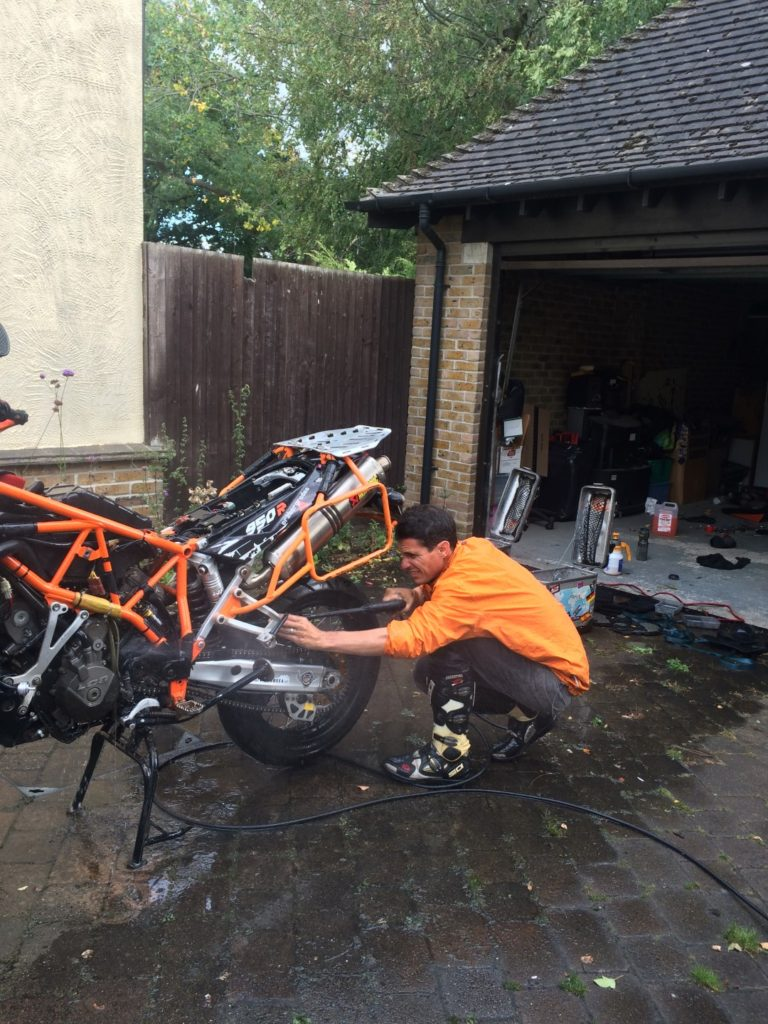Dean cleaning the bike...